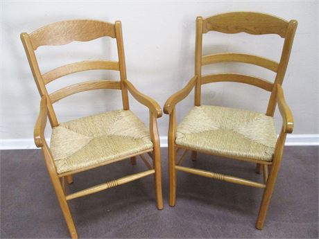 LOT OF 2 OAK RUSH SEAT ARM CHAIRS