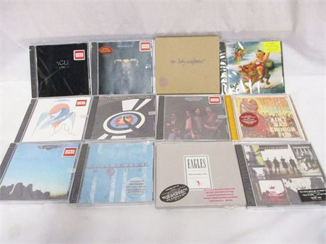 LOT OF 12 UNOPENED CDs FEATURING THE EAGLES