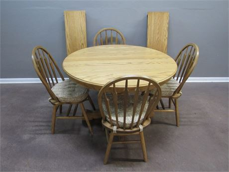 Oak Pedestal Dinette Table with 4 Arrow Back Chairs and 2 Leaves