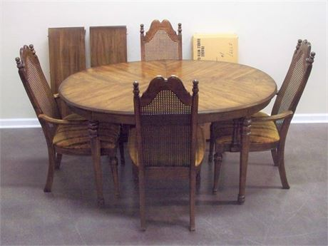 DINING ROOM TABLE WITH 2 LEAVES, PADS AND 4 CANE-BACK CHAIRS