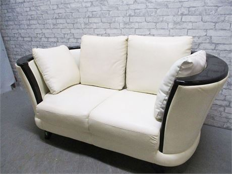 IVORY LEATHER LOVESEAT WITH WOOD ACCENT