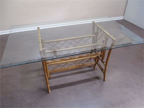 GLASS-TOPPED RATTAN TABLE