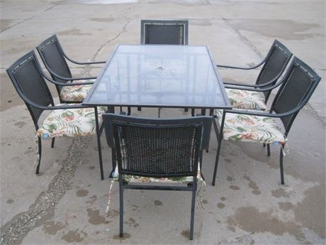 METAL AND GLASS TOP PATIO TABLE AND 6 CHAIRS