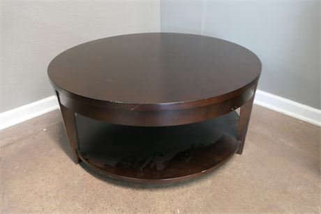 Dark Wood Round Cocktail Table on casters