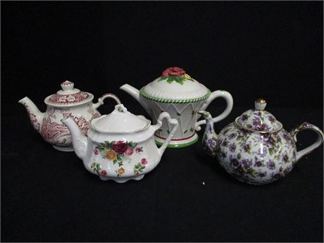 LOT OF 4 TEAPOTS FEATURING ROYAL ALBERT AND ARTHUR WOOD
