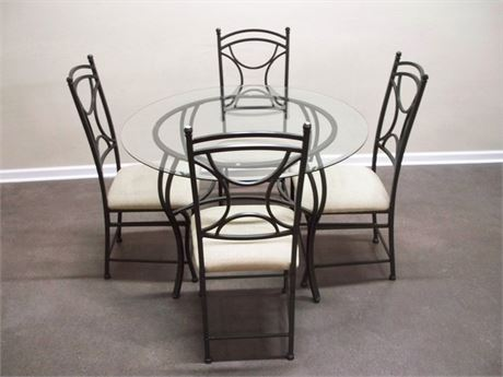 WROUGHT IRON TABLE AND 4 CHAIRS WITH BEVELED GLASS TOP