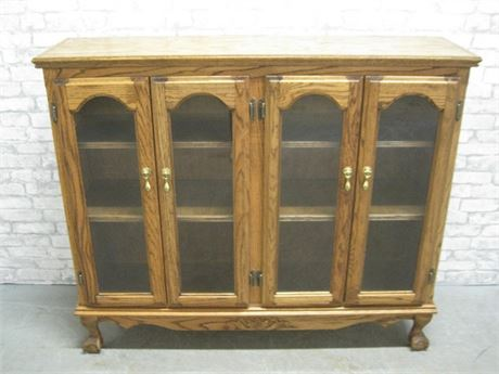 OAK DISPLAY CABINET WITH BALL AND CLAW FEET
