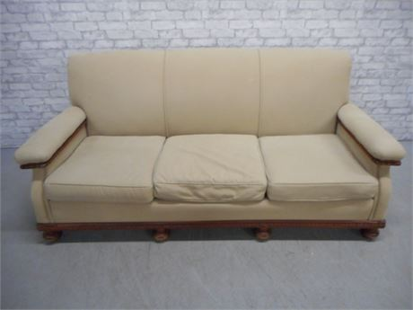 TAN SOFA WITH WOOD TRIM