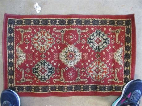 SMALL RED AND BLACK THROW RUG