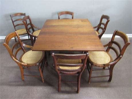 Antique Cherry Drop-leaf Table with 7 Cane Seat Chairs