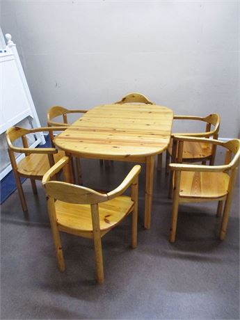KNOTTY PINE DINING TABLE AND 6 CHAIRS