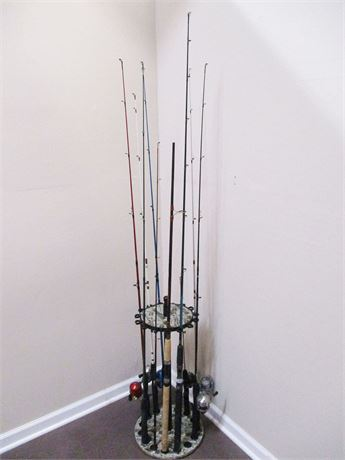 LOT OF 9 FISHING RODS IN A STAND