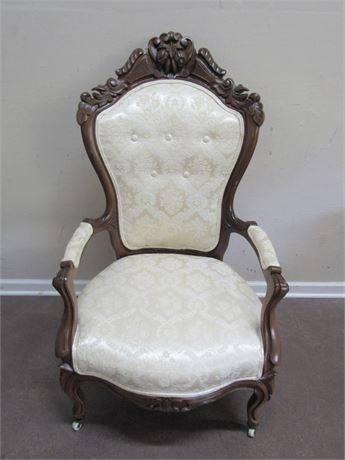 ANTIQUE VICTORIAN UPHOLSTERED ARMCHAIR WITH CASTERS