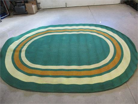 LARGE GREEN AND GOLD BRAIDED WOOL RUG
