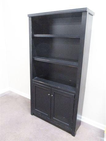 BLACK BOOKCASE WITH CLOSED STORAGE